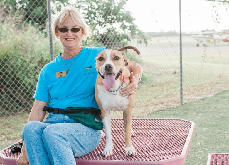 humane society naples volunteer with dog